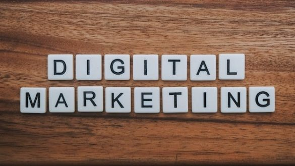 Words spelling Digital Marketing on a wooden surface.